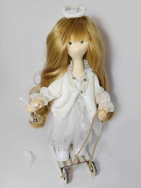 Author's Angel Christmas doll with a wooden sleigh Snow