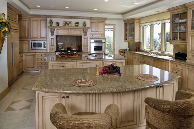Kitchen: Mediterranean, Tuscan, European Architecture, Island, Crown Molding, Ornamentation, Trim, Raised Panel Cabinet Doors, Glass Panel Cabinet Doors, Cabinet Pulls, Shelf & Corbels, Farm Sink, Oven Hood, Paint & Stained Cabinets, Granite Counter Tops, Recessed Lighting, Wood Windows, Wood Casement Windows, Glass Wood Door, Stone Floor  http://www.jamesglover.com/portfolio/belardi-residence/