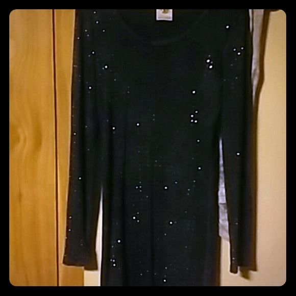 Sparkly dress Great condition. Shows off your curves ladies!? I would post a picture of me wearing it but it would do no justice, because I am currently 7mo pregnant!?? Purchased from Buckle. Vocal Dresses Long Sleeve