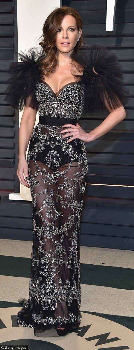 Glimmering girl: The stunning star showed off her endless legs from beneath her lengthy gown
