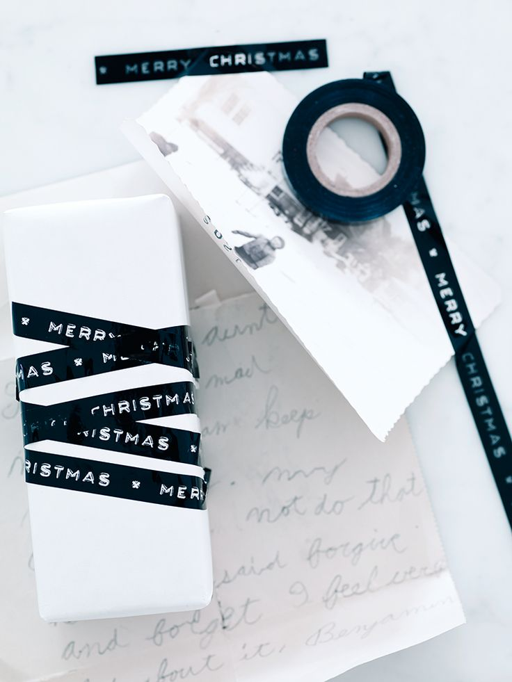 "Add a contemporary finishing touch to your Christmas gifts with our bumper 25 metre reel of dymo-style sticky tape. This gloss black tape features see-through text that reads ""Merry Christmas"" and appears when taped to colourful paper. Team with our classic Red Wrapping Paper for a stylishly wrapped gift."