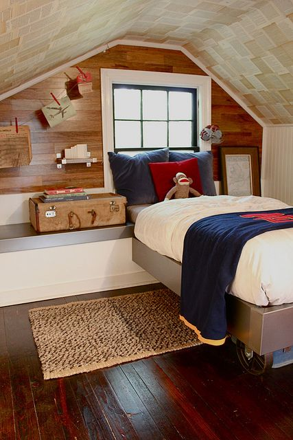 What a cool attic bedroom! From the bed on wheels to the clothespin art hangings, it's a stylish solution for a small space.