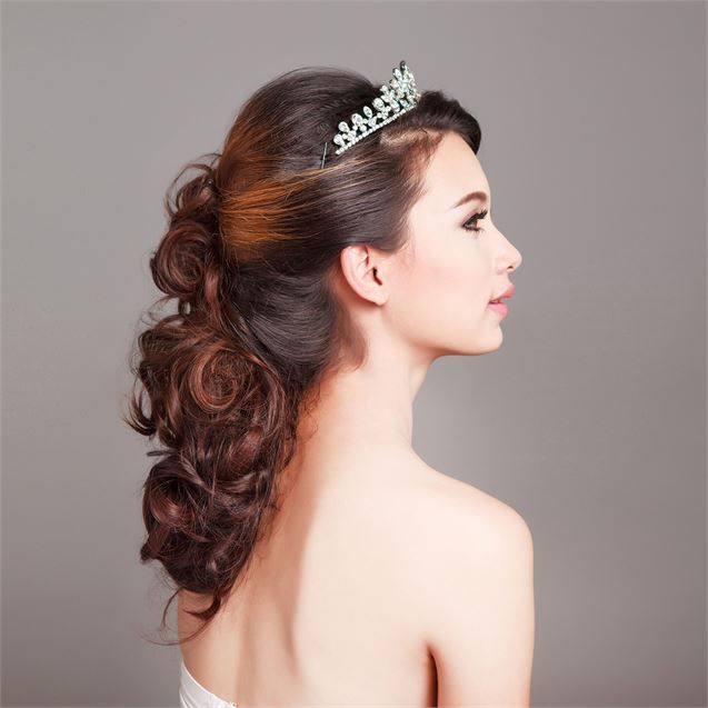 A really pretty half up,  half down hair style for a bride with curly hair.