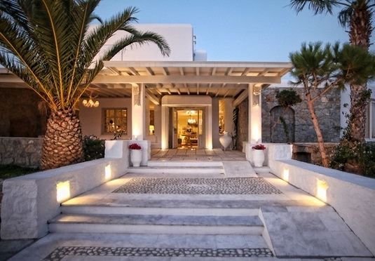 An award-winning, five-star hillside retreat with pristine whitewashed interiors and Mediterranean dining - half board and transfers included