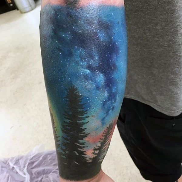 Forest and Milky Way tattoo .