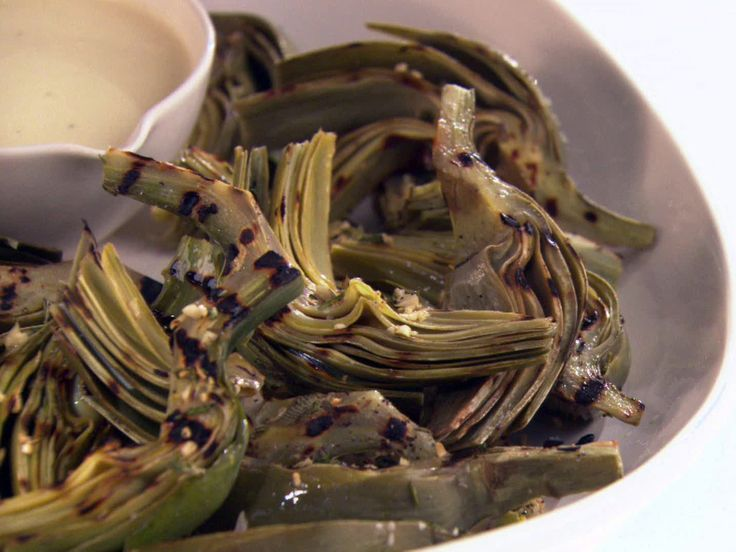 My new favorite way to cook Artichokes! Grilled Artichokes with Creamy Champagne Vinaigrette from FoodNetwork.com