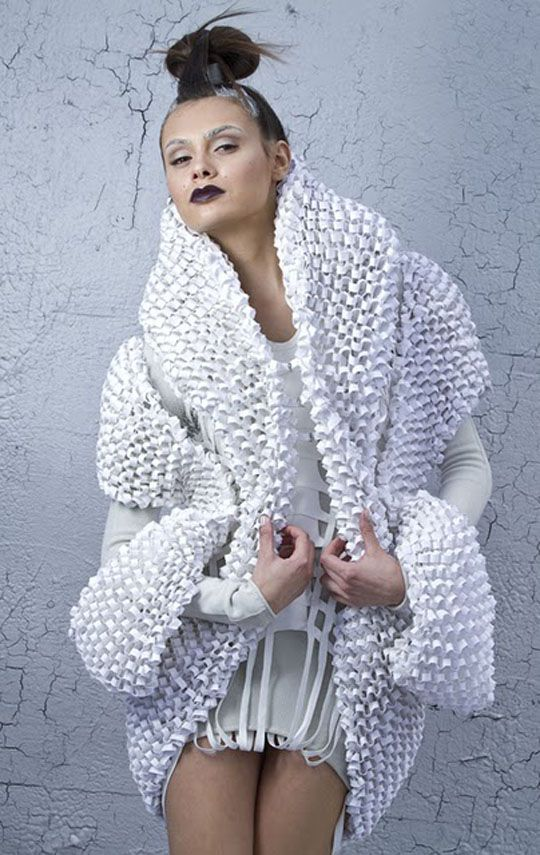 1 of 2: Elin Johansson. Front: The coat is made of cotton paper, cut into strips and glued together and then hand knit to shape.