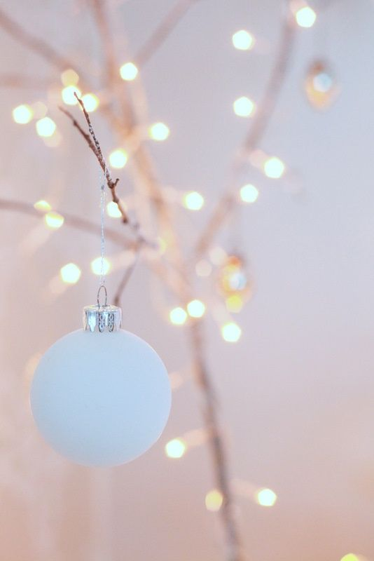 it would be beautiful to do a whole tree like this - fairy lights and light blue ornaments. you could also add in some gold ornaments to make it more festive!