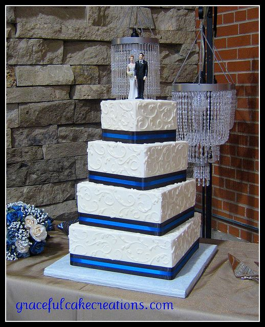 Blue and White Square Wedding Cake.  I like the accent color trim to the cake.  also the slight rotation of each layer.