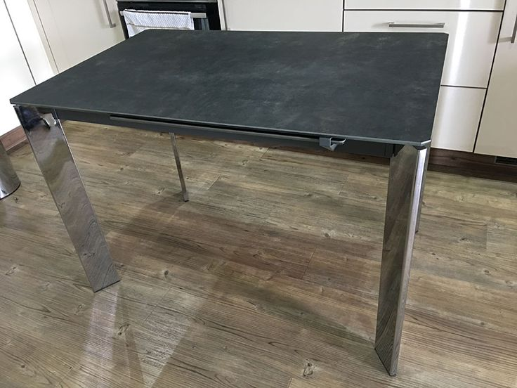 Small Link ceramic top extendable dining table with chrom legs. Extensions neatly stored under the table and deployed easily. Modern and compact table. Delivered to our client in London.