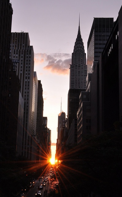 The twice-annual phenomenon of Manhattanhenge, where the setting sun aligns perfectly with Manhattan's east/west streets. I want to experience this!