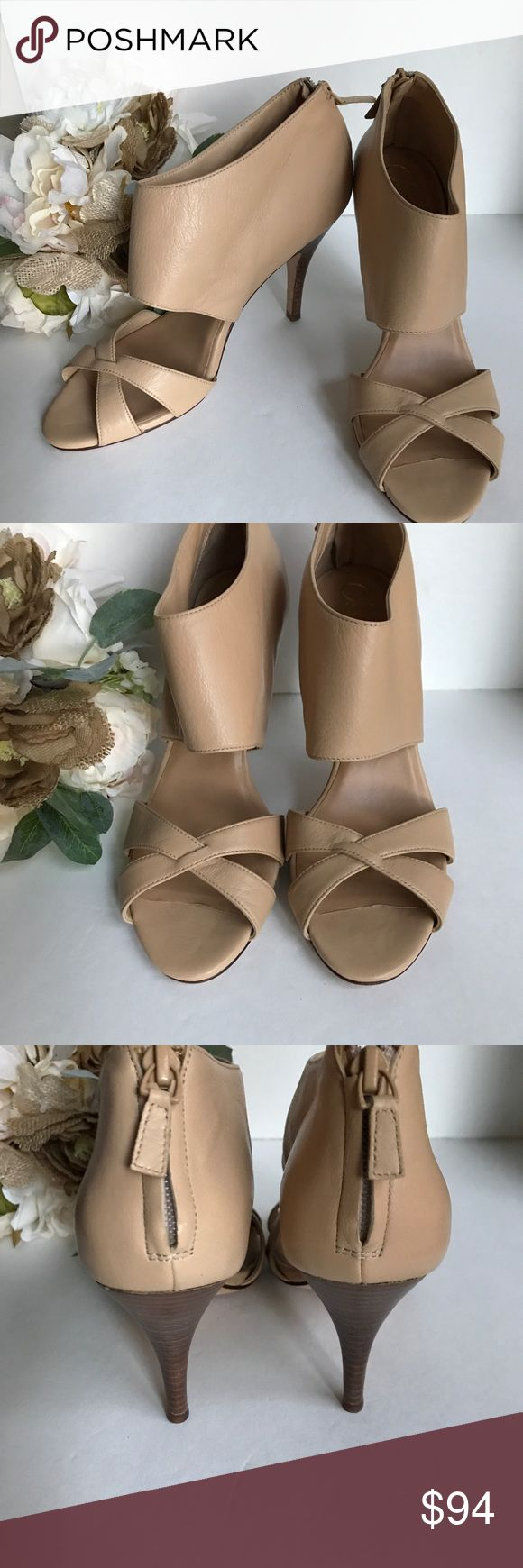 "Cole Haan 100% leather cream heels Excellent Used Condition.  Got sticky sticker stuff on bottom. Sorry couldn't get it off.  Heel 4"" Gorgeous Heals. Zip closure. Cole Haan Shoes Heels"