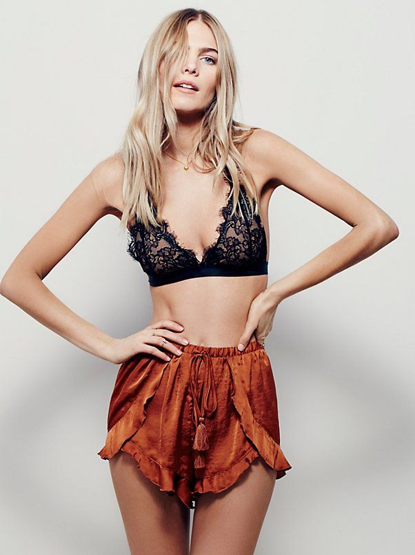 Cascading Petal Short   These silky ruffled lounge shorts are feminine and romantic, featuring a stretchy waistband and silk drawstring ties with tassel ends. Side overlay for a subtle peek-a-boo effect.