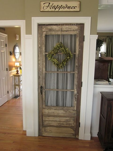 Old door on a kitchen pantry.  (except i would make the door a cool distressed turquoise :)