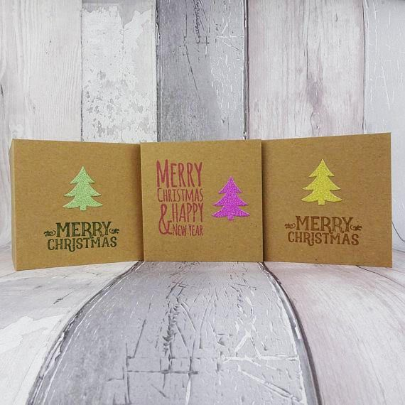 These Kraft mini handmade Christmas cards are 4 inches wide and 4 inches tall and feature a Christmas tree embellishment cut out of glitter card with a selection of messages and colours for you to personalise your cards.  The message on the front of the card is hand stamped with same colour ink to match the Christmas tree embellishment.  These cards are available in packs of 6 or 12, with an additional saving on the 12 packs.  PERSONALISING YOUR CARDS: You can choose from the following…
