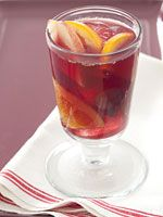 <3 skinny-sangria  Just slice up 4 apples and 3 oranges. Combine fruit with 1 pound red grapes, halved; 3 bottles light- to medium-bodied red wine; 1 can Fresca (or any diet lemon soda); and 1 can club soda. Chill mixture, and serve over ice for 16 servings