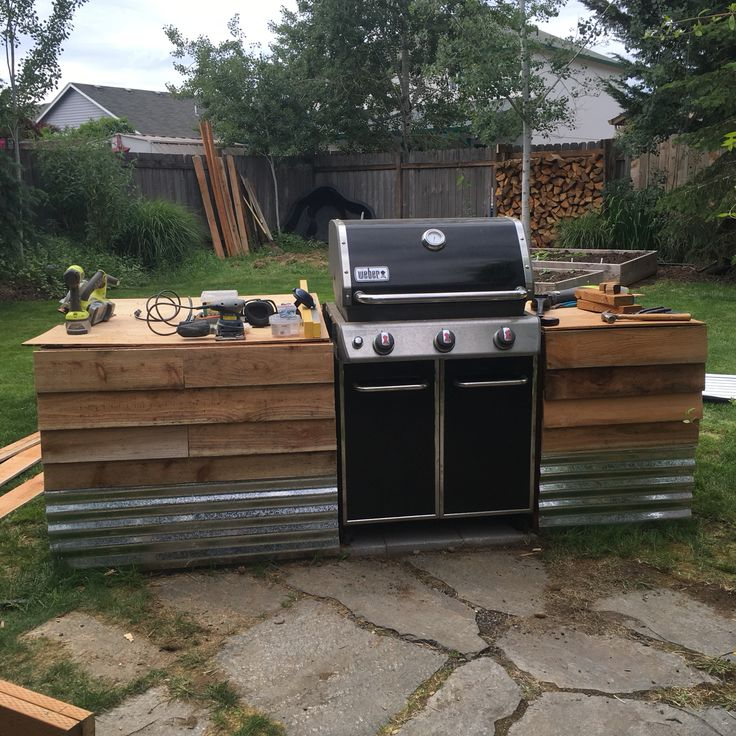 Added the corrugated aluminum and cedar to the BBQ station