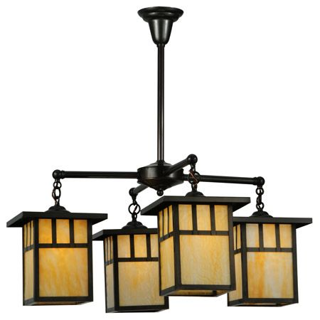 Craftsman chandelier with four lights made of beige art glass.
