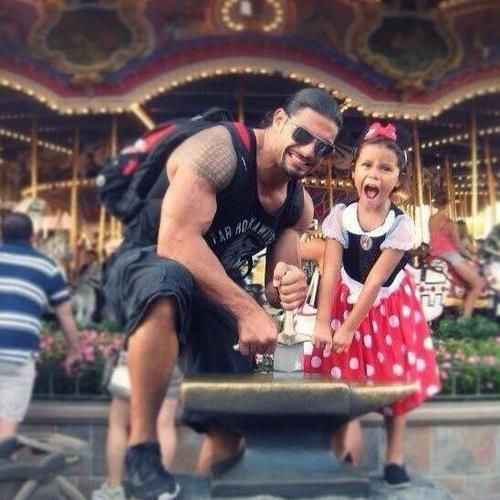 Joe Anoa'i and his cute little daughter... or is that Minnie Mouse ;)