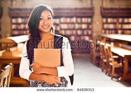 A portrait of an Asian college student in library
