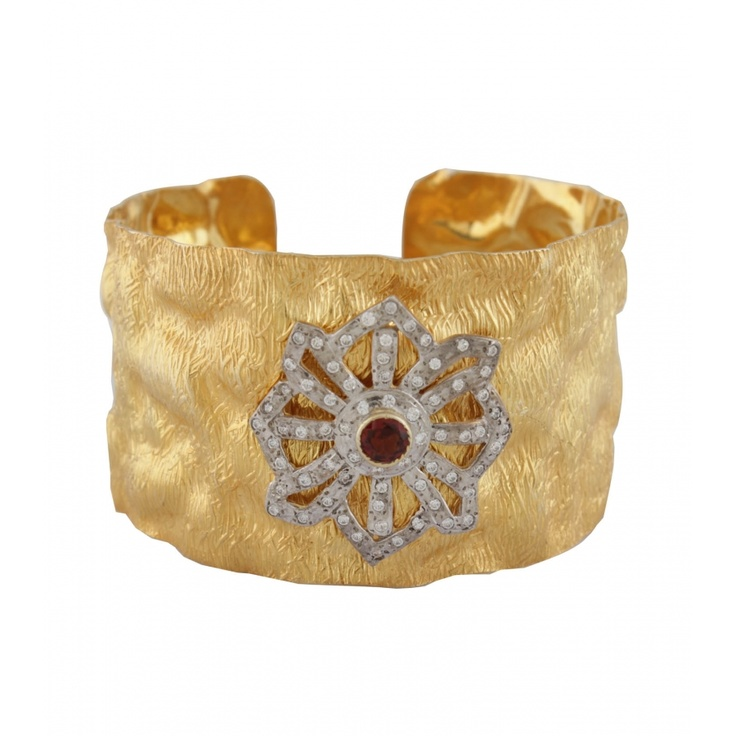 Rich Studded Flower Cuff. The mesmerising wavy texture of this accessory will please you. The unique combination of gold-plated Sterling Silver & Cubic Zircon results in this special cuff. Its exclusive design and sheer elegance will make you stand out in a crowd. $176