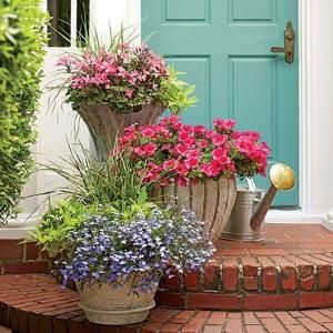 Romantic Stair Step Pots | 'Caliente Pink' geraniums, 'Surfinia Rose Veined' petunias, and 'Techno Heat Light Blue' lobelias create a soft and feminine color palette for this doorstep welcome. | SouthernLiving.com by Divonsir Borges