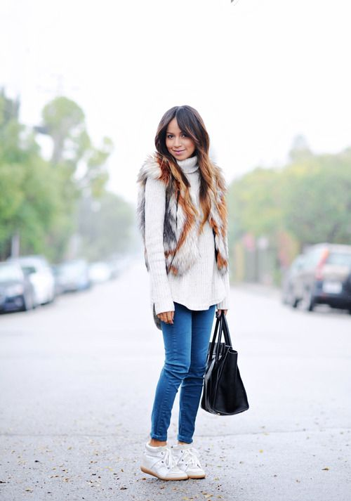Faux fur vest: Cynthia Vincent (jacket here) |  Turtleneck: H (current)  |  Jeans: Paige Denim  |  Sneakers: Isabel Marant(image: sincerelyjules)