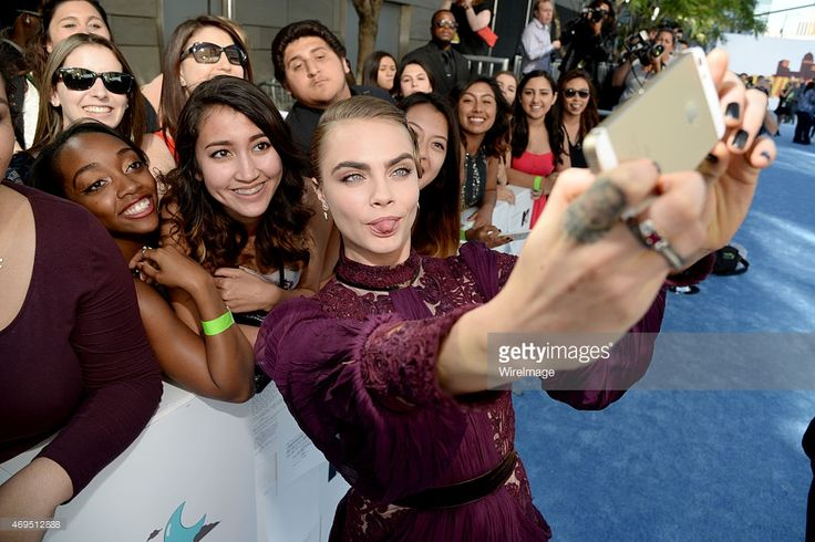 Cara Delevingne takes a selfie with fans at the 2015 MTV Movie Awards (Photo by Kevin Mazur) | #selfie #LA