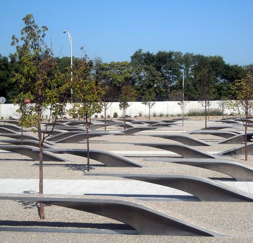The Pentagon Memorial in Arlington VA honors the 184 victims of the September 11, 2001 terrorist attacks at the Pentagon building. The Pentagon Memorial has 184 illuminated benches, one for each person who died.  Clusters of Paperbark Maple trees share the area with  benches that rise up out of the ground to form flowing, unbroken lines with pools of light radiating from underneath. The benches arranged according to victim's ages, 3 to 71, face the flight pattern of the fallen plane.