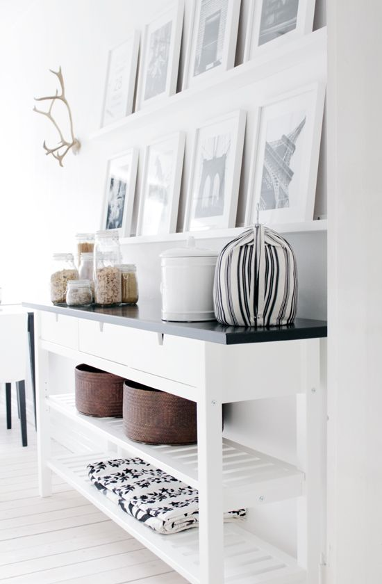 This is from a kitchen, but i could totally imagine this would be good for an entryway too. shelves + photo art via 365