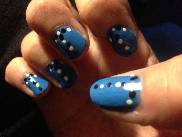 Blue with black and white spots