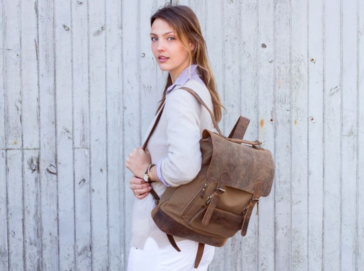 Try our gorgeous leather and canvas backpack that was designed so you can carry it all! Meet The Raleigh backpack; functionality is met with vintage/boho style for this winning canvas rucksack. #backpack #canvas #leather #giftsforher