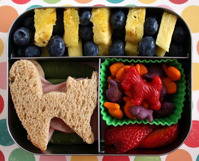 fruit kabob, cat sandwich, goldfish, and strawberries