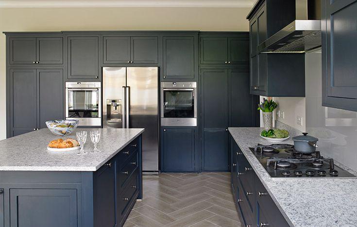 Esher Kitchen design with dark blue/navy cabinets and white grey granite worktops.