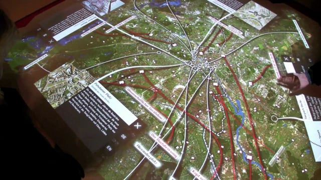 """Multitouch table in the Red Town Hall, Berlin, 2009. In collaboration with ART+COM.  Being part of the """"Be Berlin"""" campaign, the interactive table in the shape of the city of Berlin, located in the foyer of the main municipal building (Rote Rathaus) Berlin shows descriptions of sights and stories from Berliners on a satellite map.  More Info: markuslerner.com/projects/interactive-city-map-of-berlin/ artcom.de/projekte/projekt/detail/interaktiver-stadtplan/"""