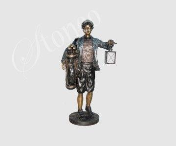 Golfista trzymający lampion - świeczniki z brązu