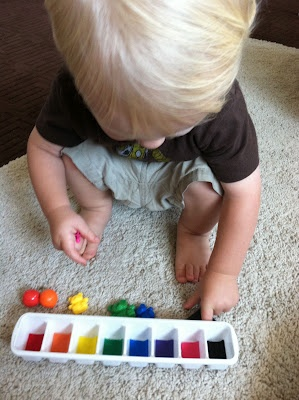 One year old activities: felt glued to ice cube tray for color
