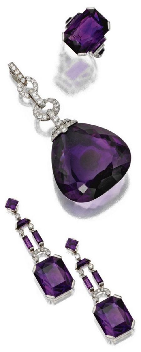 An Art Deco amethyst and diamond parure, Marzo, Paris, circa 1930. Comprising a pendant, a ring and a pair of pendant-earrings, each composed of amethysts and diamonds, mounted in platinum and white gold. Signed Marzo, Paris, with assay marks.