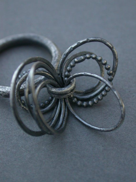 kinetic toy ring loops circles of metal mobile contemporary art jewelry jaime jo fisher oxidized sterling silver.