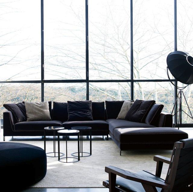 Fancy - Charles Sofa by Antonio Citterio for $5500 USD   Exquisite sofa and room! I love the striking black accents of furniture within this white space. And the floor to ceiling windows let in amazing sunlight to heighten the elegance of the room.