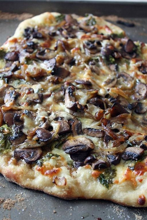 This caramelized onion mushroom and lambs quarters (or use arugula) pizza is packed full of flavor and seasonal ingredients. If you can't find lambs quarters try arugula.