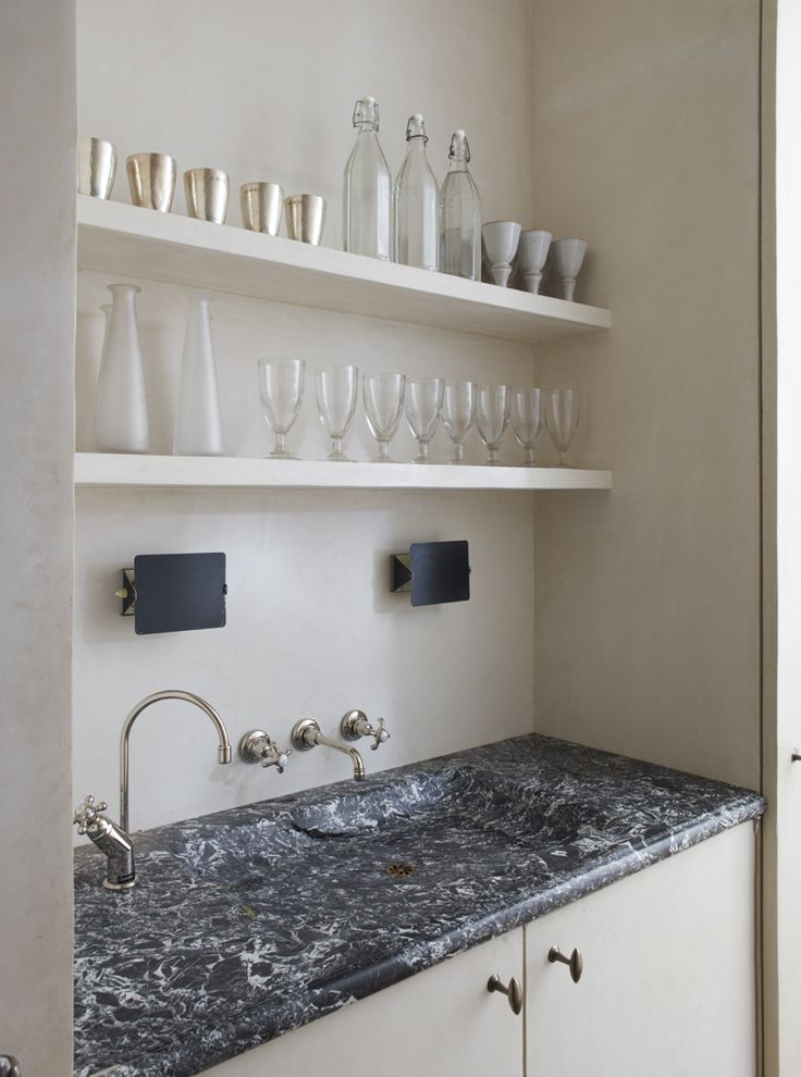 Rose Uniacke's bar sink, complete with a pair Charlotte Perriand sconces, in her Pimlico House in London.