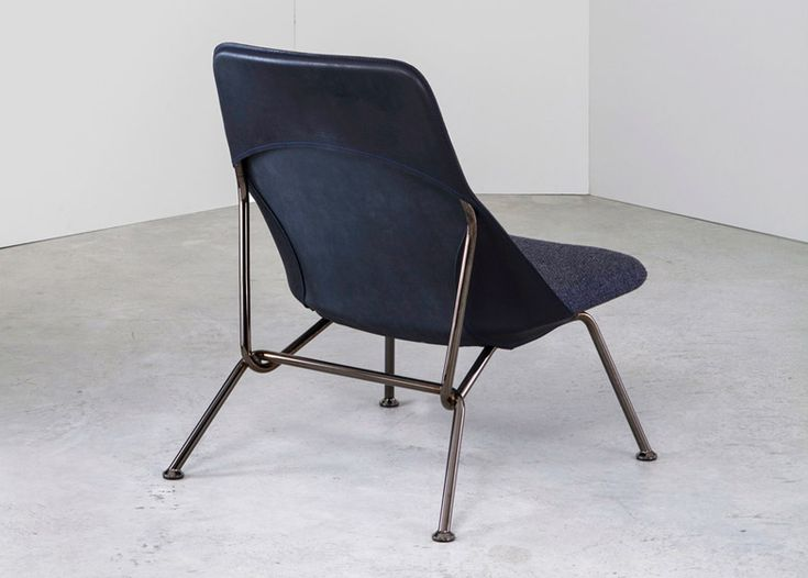Strain chair features Italian leather stretched over a steel frame:
