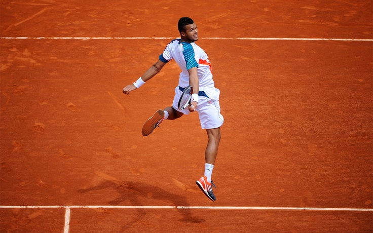 Jo-Wilfried Tsonga of France busts some new moves while celebrating his win over Jarkko Nieminen.