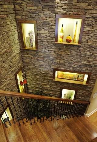 What a statement this stairway makes!  The stacked stone is so cozy!