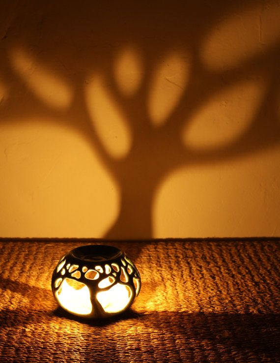 I love the shadowy tree created by this oil warmer. https://www.etsy.com/listing/241545397/forest-essential-oil-burner
