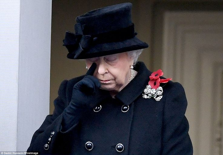 The Queen appeared emotional as she watched the ceremony below for Remembrance Sunday