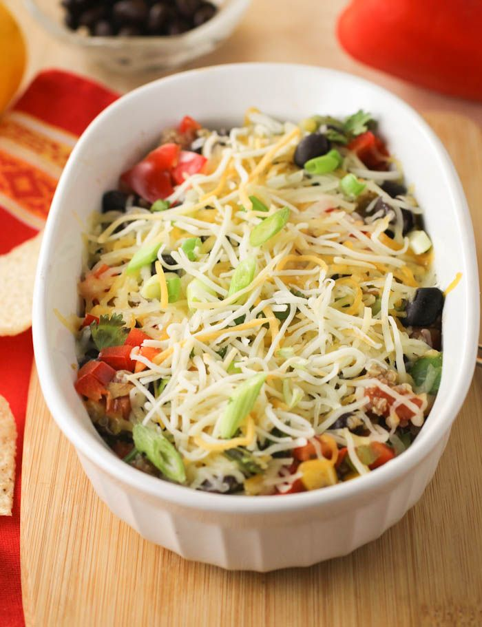 Mexican Quinoa Casserole. Rich spices, lots of veggies, plenty of quinoa, delicious black beans, and melted cheese.