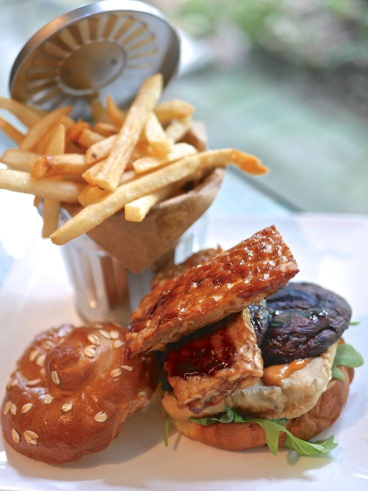 A large, juicy Portobello mushroom cap -- roasted, then served between two soft and fluffy Kaiser brioche buns (with a thick slab of soft tofu, two fried pieces of teriyaki-glazed tempeh, few leaves of fresh rocket. Finished with a smear of house-made Marie Rose sauce. Served with a bucket of hand-cut truffle fries.