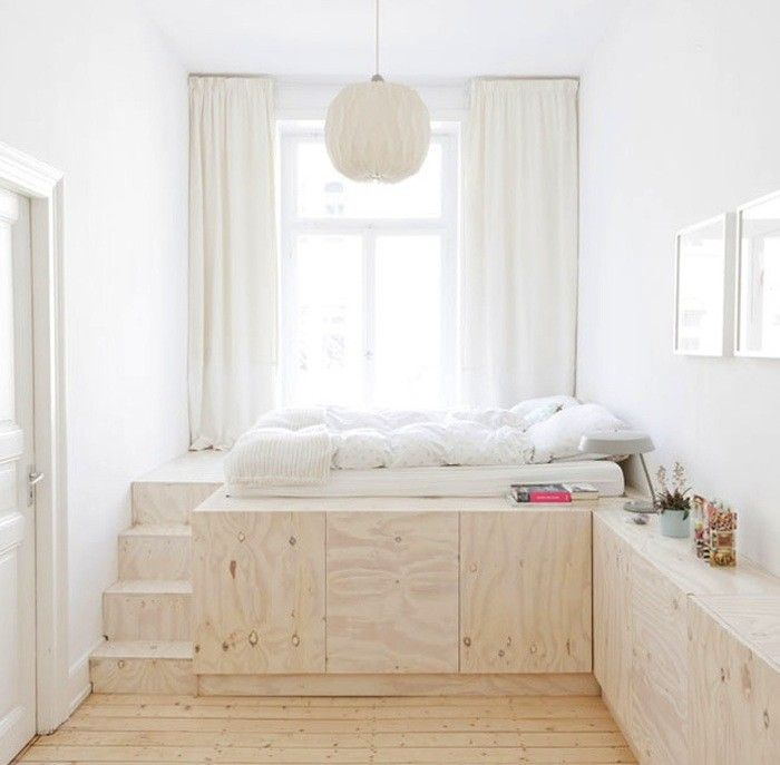 a great built in platform bed with storage in natural plywood perfect for a multi functional space